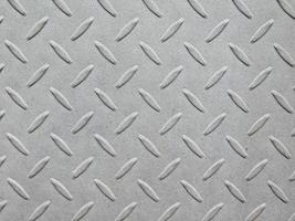 Platte aus gemustertem Metall für Hintergrund oder Textur foto
