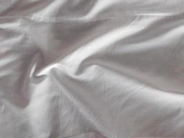 Detail eines weißen Bettlaken foto