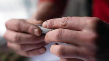 Zigarette mit Marihuana, gemeinsame Nahaufnahme foto