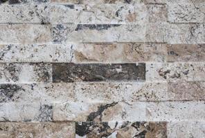natürliche Fassade Steindekoration Quarzit Hintergrund Textur. moderne Granitsteinmauer foto