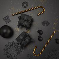 elegante Weihnachtsdekorationen in Schwarz und Gold foto