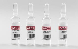 vorbeugende Coronavirus-Impfstoffflaschen foto