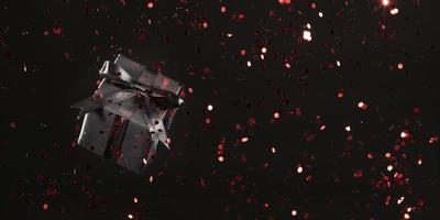 schwarze Geschenkbox mit rotem Glitzer auf schwarzem Hintergrund foto