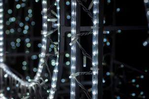 abstrakte Hintergrundmuster kleine Lampen auf schwarzem Hintergrund Nahaufnahme foto