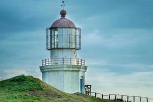 Landschaft mit Blick auf den Leuchtturm am Kap schwenkbar. foto