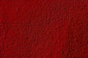 strukturierter roter Hintergrund des Wandputzes foto