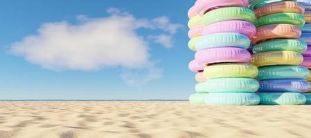 Turm der aufblasbaren Ringe am Strand, 3d rendern foto