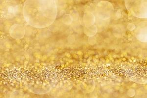 Goldstaub elegant mit Bokeh abstraktem oder Texturhintergrund foto