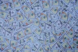 Gruppe von Geldstapeln von 100 US-Dollar Banknoten als Hintergrundstruktur foto