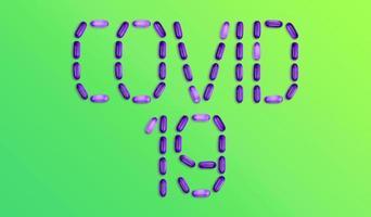 Covid 19 Wort aus Medizinpillen auf grünem Hintergrund foto