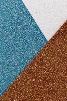abstrakter Hintergrund der blauen, weißen und goldenen Glitzerbeschaffenheit foto