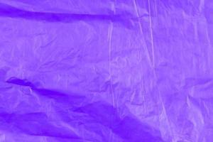 abstrakte Textur des lila Cellophan-Müllsacks foto