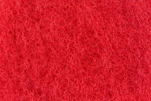 abstrakte Textur der roten Oberfläche eines Waschlappens foto
