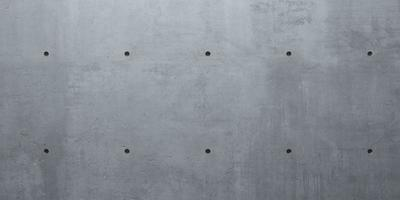 grauer Wandbeton monolithischer Hintergrund industrieller Bau foto