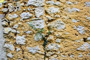 Stein und gelbe Wand foto