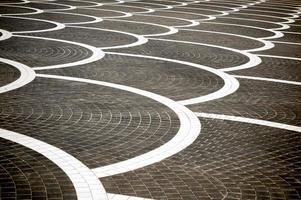 kreativer quadratischer Schichthintergrund mit weißem geschwungenem Linienmuster foto