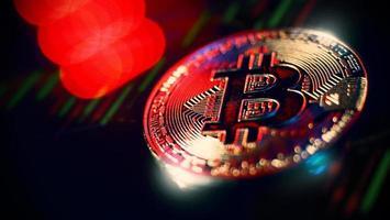 Kryptowährung Bitcoin und Börsengrafikbalken foto
