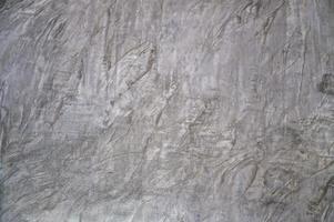 Hintergrundputz rauer grauer Zementmörtel als Designhintergrund verwendet foto