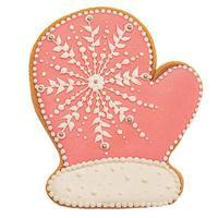 Neujahrs. rosa Ingwer-Cookie-Handschuh auf weißem Hintergrund. Weihnachtsrosa Lebkuchenhandschuh. foto
