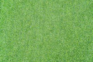 Draufsichtfoto, künstlicher grüner Grasbeschaffenheitshintergrund foto