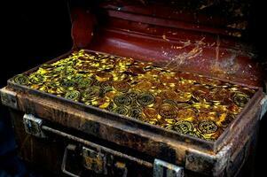 Goldmünze in Schatzkiste stapeln foto