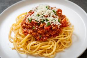 Spaghetti Bolognese-Schweinefleisch oder Spaghetti mit Hackfleisch-Tomatensauce - italienische Küche food foto