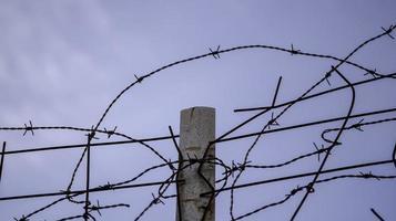 Einwanderung aus Stacheldraht foto