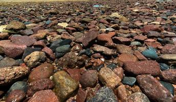 Steinbeschaffenheitsmuster am Strand Rotes Meer Dahab Ägypten foto