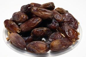 Dattelbrühe auf Schüssel zum Essen am Ramadan foto