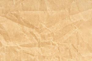 zerknittertes Kraftpapier Textur Hintergrund. hellbraune Farbe foto