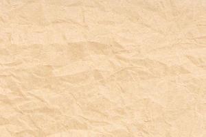 zerknittertes Papier Textur Hintergrund. hellbraune Farbe foto