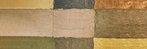 Hintergrund einer Wand aus bunten Rechtecken mit Farbe gezeichnet foto
