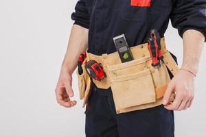 Handwerker mit Werkzeuggürtel foto