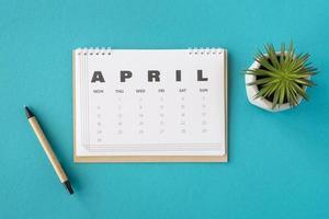 Draufsicht Planer April Kalender Sukkulente. hochwertiges schönes Fotokonzept foto