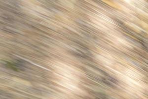 Hintergrund aus beigefarbenen Streifen und unscharfen hellen Bereichen foto