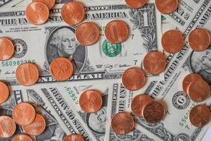 Dollarmünzen und Banknoten foto