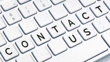 Kontaktieren Sie uns Wort auf der Computertastatur foto