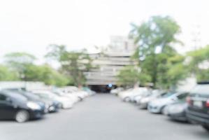 abstraktes verschwommenes Parkauto für den Hintergrund foto