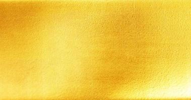 glänzende gelbe Blattgoldfolienstruktur foto