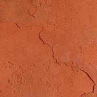 roter rauer Steinbeschaffenheitshintergrund. foto