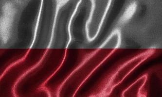 Tapete von Polenflagge und wehende Flagge von Stoff. foto