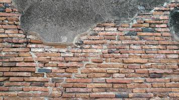 alter Backsteinmauerbeschaffenheitshintergrund foto