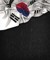 Südkorea-Flagge Vintage auf einer schwarzen Grunge-Tafel foto