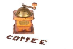 Kaffeemühle mit geschriebenem Kaffee aus Getreide foto
