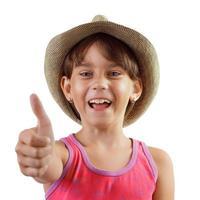 fröhliches, glückliches, charmantes Mädchen mit Hut foto
