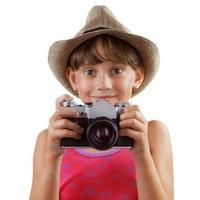 glückliches Mädchen mit einer Filmkamera foto