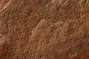 unebene Oberfläche aus braunem Stein foto