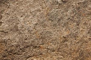Oberfläche des Steins graubraun foto