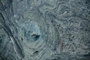 steingrau mit dunklen Flecken foto