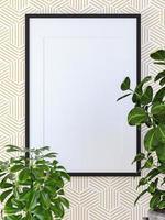 weißer Bilderrahmen an der Wand mit kleinen Pflanzen foto